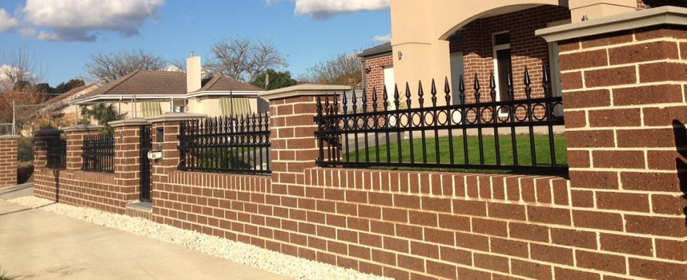 Redbrick fence with black tubular inlays